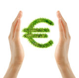 Female hands holding euro sign. Made of green grass Royalty Free Stock Image