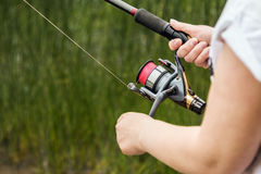 Female hands holding a fishing rod feeder Royalty Free Stock Images