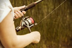 Female hands holding a fishing rod feeder Stock Images