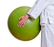 Female hands holding fitball. Royalty Free Stock Photos