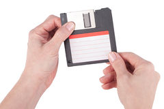 Female hands holding floppy disk Stock Image