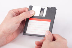 Female hands holding floppy disk Royalty Free Stock Image