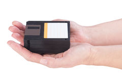 Female hands holding floppy disks Stock Photography