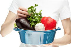 Female hands holding fresh vegetables Royalty Free Stock Photo