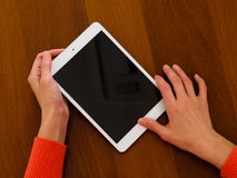 Female hands holding generic tablet Stock Photography