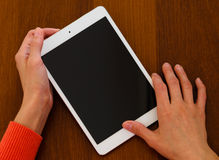 Female hands holding generic tablet Stock Image