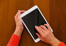 Female hands holding generic tablet Royalty Free Stock Photography