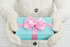 Female hands holding gift box Stock Images