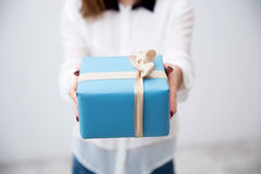 Female hands holding gift Stock Photos