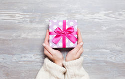 Female hands holding gift royalty free stock image
