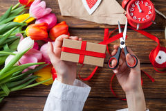 Female hands are holding a gift Stock Photo