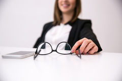 Female hands holding glasses Stock Images