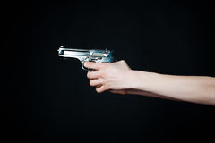 Female hands holding gun Stock Photo