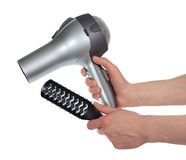 Female hands holding hair dryer Stock Photography