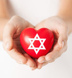 Female hands holding heart with star of david Royalty Free Stock Photo