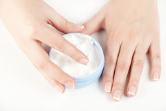 Female hands holding jar of creme Royalty Free Stock Photography