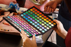Female hands holding makeup colorful palette Stock Photography