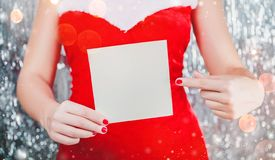 Female hands holding Merry Christmas card or letter to Santa. Xmas and New Year theme. royalty free stock photo