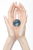 Female hands holding mother earth. Isolated on white Stock Photo