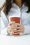 Female hands holding mug Royalty Free Stock Photography
