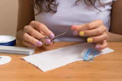 Female hands holding nail clippers Royalty Free Stock Image
