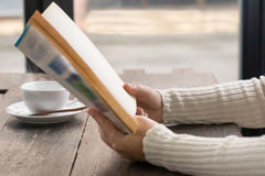 Female hands holding old opened book . Royalty Free Stock Photography