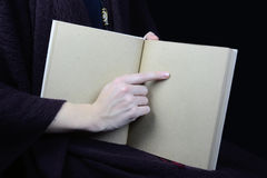 Female hands holding an open book Stock Images
