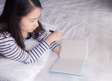 Female hands holding pen and opened diary book Stock Image