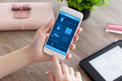 Female hands holding phone with app smart home on screen Royalty Free Stock Photos