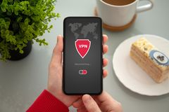 Female hands holding phone with app vpn private network. Female hands holding phone with app vpn creation Internet protocols for protection private network above royalty free stock image