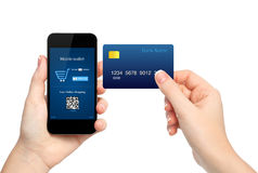 Female hands holding phone and credit card making a purchase onl Stock Images