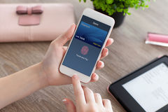 Female hands holding phone with debit card touch and pay Royalty Free Stock Photography