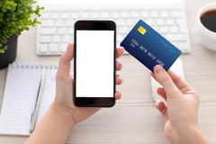 Female hands holding phone with isolated screen and credit card Royalty Free Stock Images