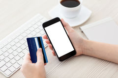 Female hands holding phone with isolated screen and credit card Royalty Free Stock Photography