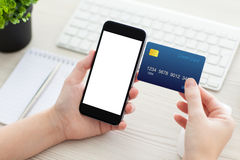 Female hands holding phone with isolated screen and credit card Stock Photos