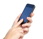 Female hands holding phone and touches the screen Stock Image