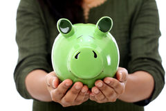 Female hands holding a piggy bank Stock Photo