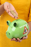 Female hands holding a piggy bank Royalty Free Stock Photos