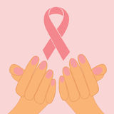 Female hands holding pink ribbon Stock Images