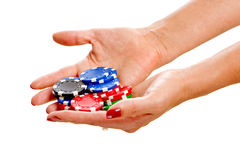 Female hands holding poker chips Stock Photo