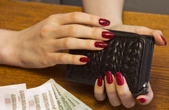 Female hands holding a purse with money Stock Photo