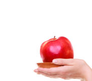 Female hands holding red apple healthy fruit isolated Stock Photo