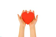 Female hands holding red Valentines card with heart on a white b. Ackground royalty free stock photo