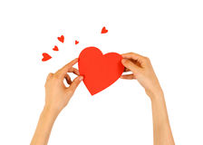 Female hands holding red Valentines card with heart on a white b. Ackground stock photo