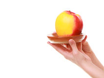 Female hands holding red yellow apple healthy fruit isolated Stock Photos