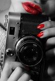Female hands holding retro camera stock image