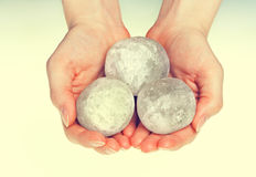 Female hands holding round salt crystals Royalty Free Stock Photo