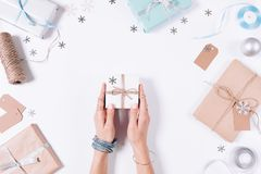 Female hands holding a small box with a gift Royalty Free Stock Image
