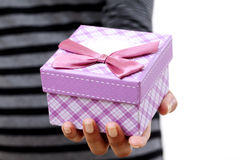 Female hands holding small gift box Stock Photos