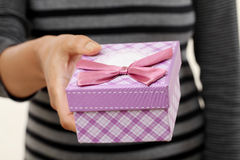 Female hands holding small gift box Royalty Free Stock Photos